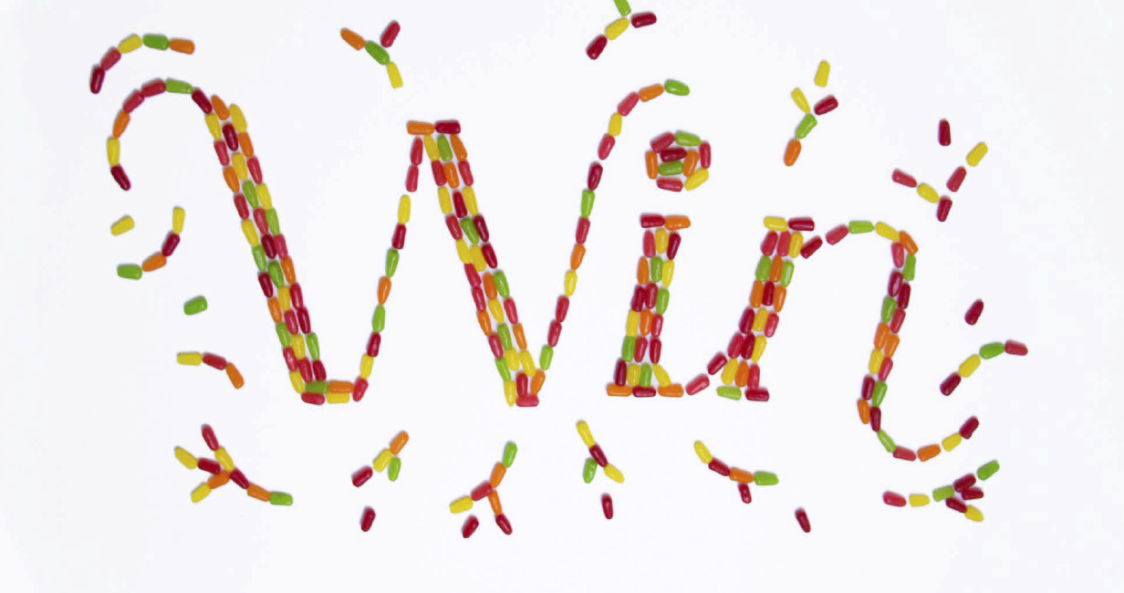 win! spelled out with candy